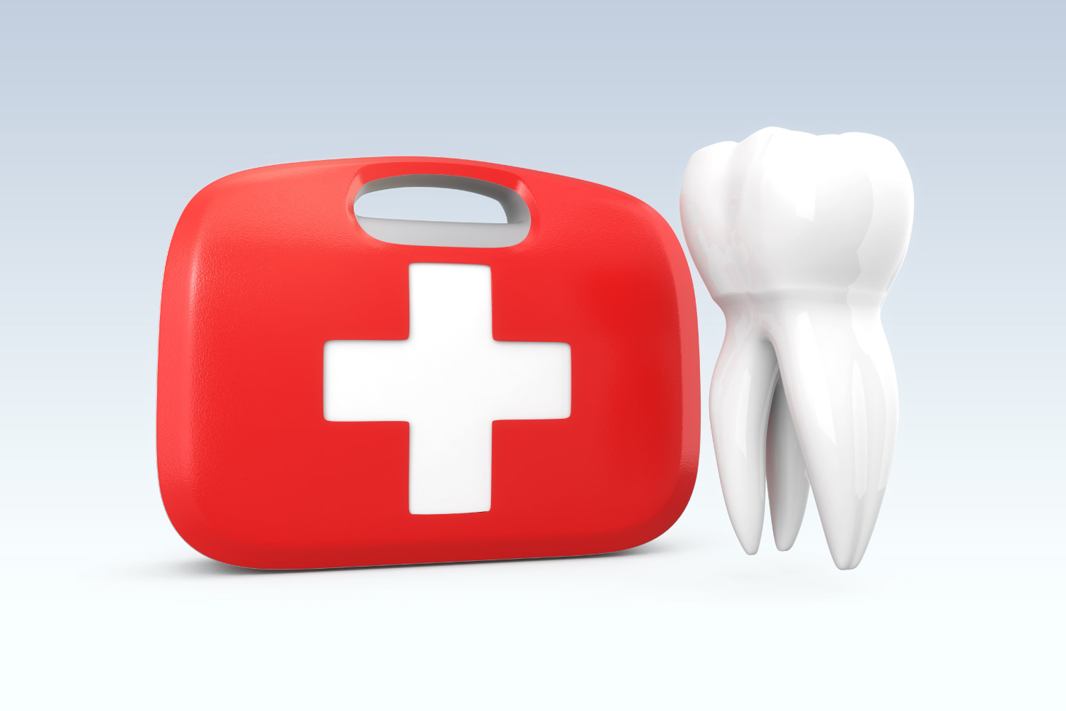 A red first aid kit next to a white tooth to indicate a dental emergency in Denver, CO