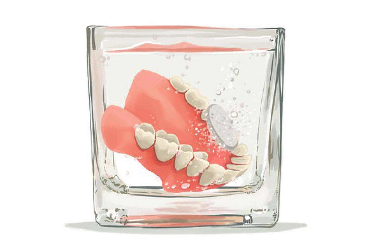 Dentures sitting in a cup getting cleaned.
